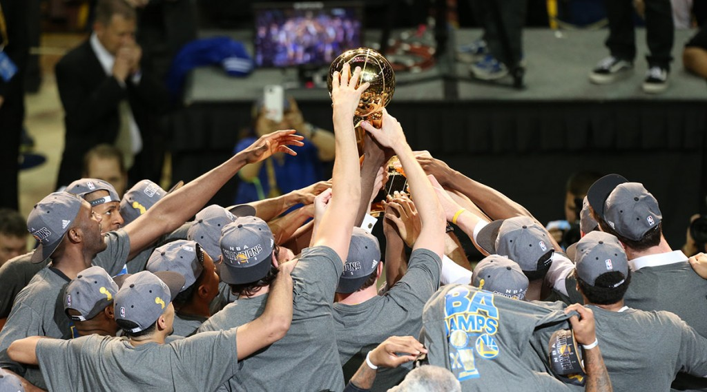 CLEVELAND, OH - JUNE 16: The Golden State Warriors hold up the Larry O'Brien Championship Trophy and celebrate winning Game Six of the 2015 NBA Finals against the Cleveland Cavaliers on June 16, 2015 at Quicken Loans Arena in Cleveland, Ohio. NOTE TO USER: User expressly acknowledges and agrees that, by downloading and/or using this photograph, user is consenting to the terms and conditions of the Getty Images License Agreement. Mandatory Copyright Notice: Copyright 2015 NBAE (Photo by Joe Murphy/NBAE via Getty Images)