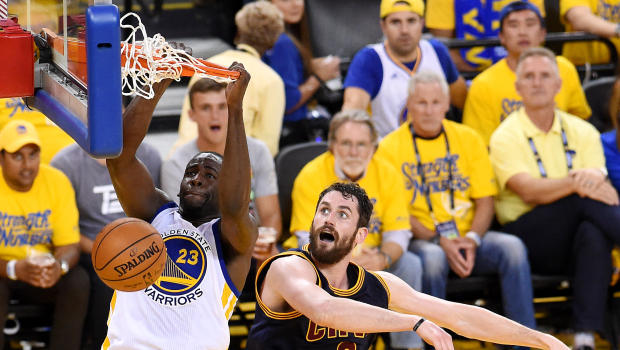 Jun 2, 2016; Oakland, CA, USA; Golden State Warriors forward Draymond Green (23) dunks the ball against Cleveland Cavaliers forward Kevin Love (0) in game one of the NBA Finals at Oracle Arena. Mandatory Credit: Bob Donnan-USA TODAY Sports